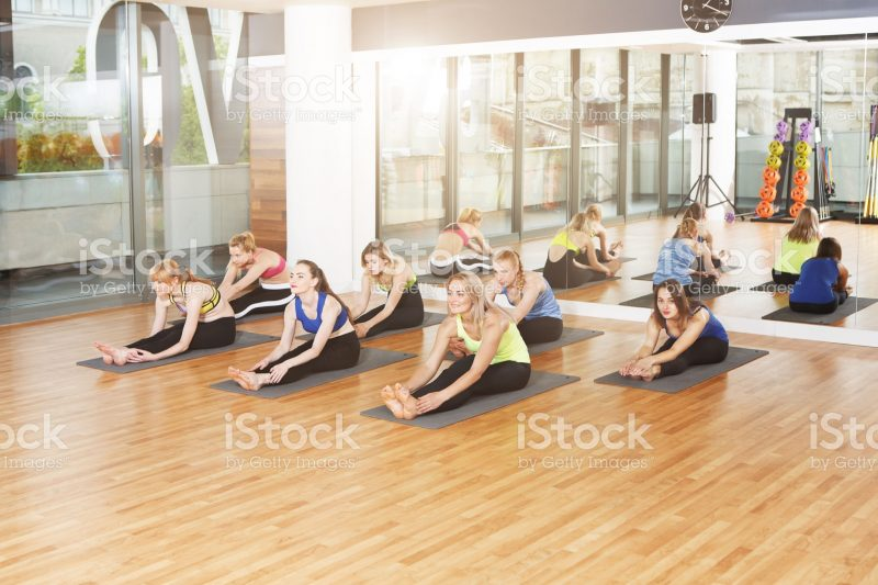 Group of young women in yoga class.