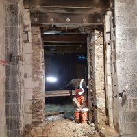 man repairing foundation