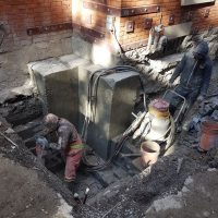 men fixing the foundations of a house